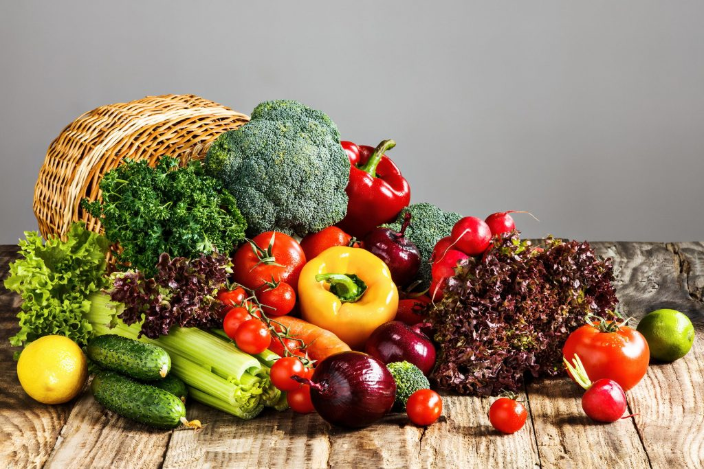 vegetables from basket wooden table